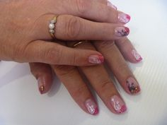 Pink and orange gel polish french tips with glitter and konad stamps