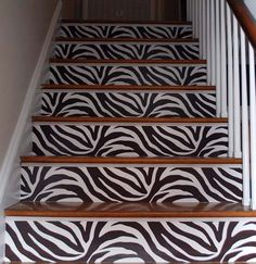 Sassy black and white zebra print staircase with WallPops! #walldecals  #wallart  #peelandstick  #WallPops  #wallstickers  #decor  #DIY  #decorating