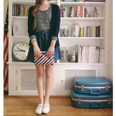 Nope. What I liked in this picture is the bookcase. Maybe her clothes are nice too though