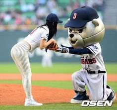 Clara Lee in  baseball suit