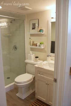 small bathroom with nice finishes, DIY shelves are a nice touch