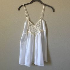 Vintage lingerie/teddy Adorable vintage baby doll silk teddy in great condition! White silk with cream lace detail and two bows. Very feminine! Can fit XXS through large depending on how loose or fitted you want it. I'm 5'2 and usually wear XS/small. NOT free people just using for visibility PLEASE DONT BE AFRAID TO MAKE AN OFFER!!! I ❤️❤️❤️ to haggle Free People Other