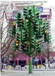 This bit of public art blends nature with traffic in one confusing sculture. It s Pierre Vivant's Traffic Light Tree. A giant sculpture of fully-functioning traffic lights in London. For some reason it s parked next to a roundabout near Canary Wharf. Street Art, Stop Light, Wow Art, Outdoor Sculpture, Traffic Light, Tree Lighting, Art Plastique, Public Art, Urban Art