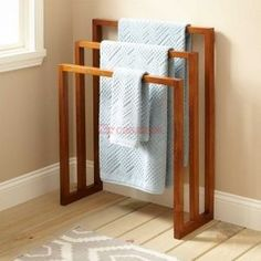This towel rack is simple and elegant, made of 100% pure teak wood. High oil content in teak makes it naturally water resistant and lasting at wet places like restrooms & spa visit casateak to know more about this product and others in its range. Toilet Tiles, Bathroom Shelves Over Toilet, Diy Bathroom, Towel Rack Bathroom, Bathroom Storage, Towel Racks, Towel Hanger, Bathroom Ideas, Bathroom Vanities