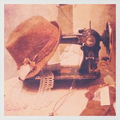 Vintage photo - sewing machine with old hat