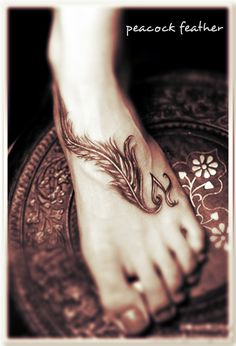 peacock feather tattoo on the foot #feather [OR, print the feather on clear contact paper for a lovely fake tattoo]