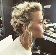Braided, twisted updo. Lots of texture. Wisps and tendrils around face.