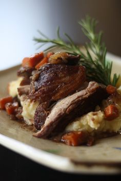 Slow Cooker... Merlot braised country style pork ribs. I used 2 1/2 lb pork ribs, 1 1/4 c beef broth and Cabernet and added some thyme and rosemary. High 2 hours, low 4.