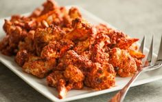 This recipe looks healthy, easy, and like the florets won't get soggy (the problem with a lot of the recipes I've seen) :: Buffalo Cauliflower Bites via Whole Foods