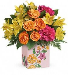 Mom is so special, she deserves two bouquets! Shower her in blossoms with this bright, joyful arrangement of orange roses, yellow alstroemeria and pink carnations. Carefully arranged in a keepsake ceramic cube, decorated with its own painterly blooms, it's a Mother's Day surprise she'll always remember.