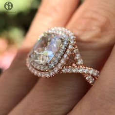 Gorgeous cushion cut double halo with a twist!