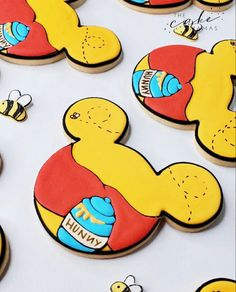 Winnie The Pooh decorated sugar cookies. Call or email to order your celebration cookies today. Click the link below to learn more! #winniethepooh #cookies #decoratedcookies #sugarcookies #royalicing #royalicingcookies #pooh #poohbear #dessert #partyideas #dessertideas #desserttable #birthday #birthdayparty
