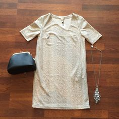 Enjoy some subtle sparkle with our #SeeUSoon dress ($98) paired with a coin clutch ($35)! Accessorize with a jeweled necklace ($35) for a complete look!