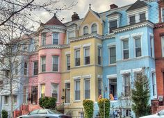 A row of pastel houses on Monroe Street, NW, in Washington, DC.  I remember this place.