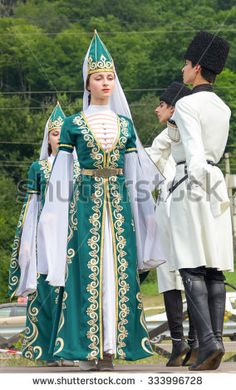 Adygea, RUSSIA - JULY 25 2015: Young guys and girls dancers in traditional Adyghe dresses, dance at an ethnofestival in the Foothills of Caucasus in Adygea - stock photo