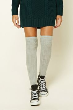 A pair of ribbed knit over-the-knee socks featuring a geo pattern and a ribbed trim.