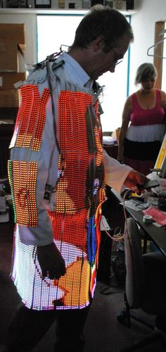 Dave Forbes wearable computer LED Coat displays video as you walk about the playa. via Geekologie http://bit.ly/pJM9Ht ( July 2011) Dave's website is http://www.cathodecorner.com/ #wearable #LED
