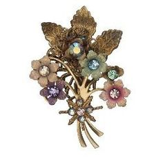 Jewelry designer Michal Negrin produces wonderful vintage inspired brooches and pins. This page showcases a selection of Michal Negrin brooches....
