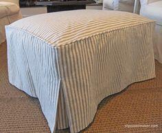 Custom ticking stripe ottoman slipcover. Simple, sewn down pleats at corners.