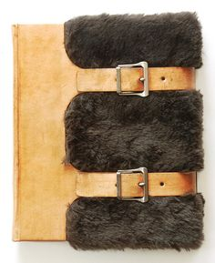 """The Call of the Wild by Jack London – Illustrated by Paul Bransom, bound by Richard Tuttle. Rebound in a combination of cowhide & beaver fur covered boards complete w/ leather straps & old buckles. The leather has a very nice patina & will age beautifully. A label w/ the title & author is affixed to the spine. The endpapers are made of ruled composition paper from a student's notebook w/ the back endpaper bearing the books title. 2012, 9.5"""" x 8"""""""
