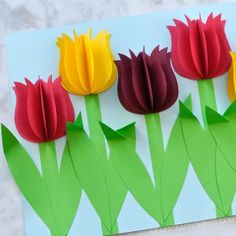 Construction paper flowers vase filled with gift wrap ribbon kid gorgeous 3d paper tulip flower craft i heart crafty things mightylinksfo