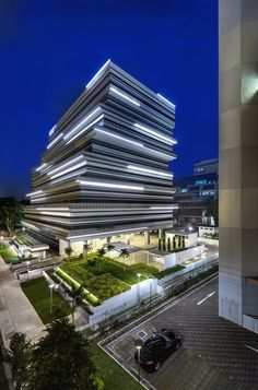 Office Building / Ministry of Design Courtesy of Ministry of Design .Courtesy of Ministry of Design . Singapore Architecture, Office Building Architecture, Building Facade, Futuristic Architecture, Facade Architecture, Amazing Architecture, Contemporary Architecture, Building Design, Chinese Architecture