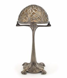 A Maurice Dufrène silvered bronze and brass table lamp circa 1900.