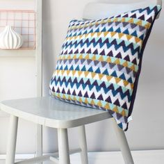 Each of these lambswool cushions is knitted by Gabrielle Vary at her workshop in Brighton. We love the geometric, retro-inspired patterns in bright, cheerful colours. £69, www.oatesandco.com.