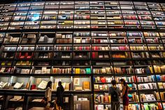 Shenzhen, China - Visitors read books on a 50-metre-long, 30-metre-high Artron Wall at the 11th International Culture Industry Fair. Photograph: AFP/Getty Images