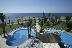Book Golden Bay Beach Hotel in East Coast of Cyprus, Cyprus with Direct Traveller special deals to Cyprus hotels. Cyprus Larnaca, Cyprus Hotels, Holiday Deals, Beach Hotels, East Coast, Tours, Places, Outdoor Decor, Travel