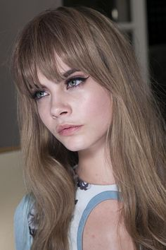 Cara Delevigne rocks the '70s bangs and a sultry cat eye for Emilio Pucci's fall 2013 collection.