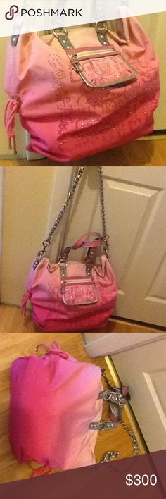 Coach pink storypatch Bling 15312 limited edition used condition. Please look at pictures for condition. Wear on handles. Wear inside and out. Dirt and staining inside out. Missing some of the crystal studs on outside. This hand bag is extra large in size. No hang tag, no dust bag. Hand bag only. Smoke free and pet free home. Please tag for any reason. Thank you. Coach Bags