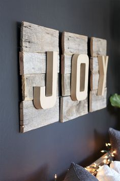 """I am all about reclaimed wood, so it absolutely made me giddy when I  thought of a way I could include reclaimed wood into my Christmas decor.  Enter this delightful """"JOY"""" DIY Christmas Sign. The full tutorial is below.  Note, this can also be made with 2 x 4s if you don't have any access to  reclaimed wood. Chances are though there is a local spot that sells  reclaimed wood in your area. Or you can always check for some abandoned  barns (well, maybe be careful on that one).  1. 4 Reclaimed…"""