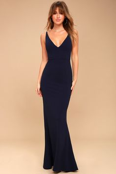 Enchantress will be your middle name when you step out in the Melora Navy Blue Sleeveless Maxi Dress! Medium-weight stretch knit falls effortlessly from tapering straps, to a darted bodice with V-neck and back. Fitted waist meets the full-length maxi skirt with a flaring mermaid hem. Hidden back zipper/clasp.
