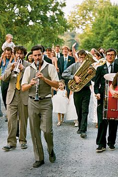 everyone walking down the street following a band to the reception haha that would be cool.