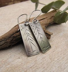 Hand fabricated, freeform evergreen tree earrings. Rectangles are forged from sterling silver sheet. I have then created a scene any nature