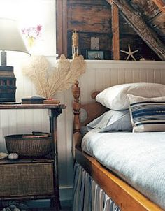 An attic nook becomes a guest room retreat. Accent with starfish and a sea fan to give it that Summer style.