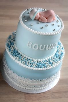 baby blue shower layered cake, with polka dots and white ribbon