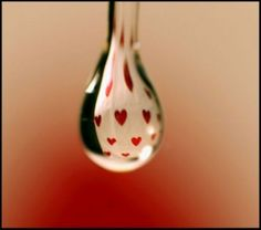 Red Hearts In Macro Water Drop.