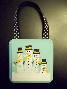 Snowman Handprint on small wooden plaque (could check Michael's or Hobby Lobby). I would use Sharpies for the decorations = easier for younger kids to control.