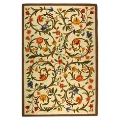 Add a pop of style to your master suite or den with this hand-hooked wool rug, showcasing a scrolling floral motif in an array of soft hues....