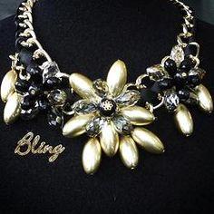 Collar de Flor Dorada con Negro Modelo 0125 $150 www.facebook.com/BlingMx