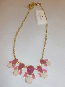 """kate-spade-k-Red-steamer-glow-mini-Necklace-WBRU9098-Orig-74-SALE steamer glow mini necklace Dainty stone clusters center a slender  necklace that adds just enough style to your look.. a row of teardrop shaped charms with faceted glass stones. Color: REDMULTI (616)  Measurements 17"""" length; 3"""" extender; 1 1/4"""" Drop. Closure: Lobster clasp   Material: 12k-gold plated /epoxy"""
