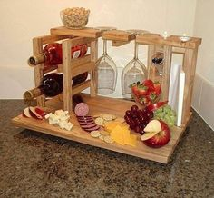 Wine and cheese party for 2 includes wine rack, glass holders, cheese cutting board made from upcycled solid pecan flooring, Ready to ship Wood Projects, Woodworking Projects, Cheese Cutting Board, Cheese Boards, Wine Caddy, Wine And Cheese Party, Wine Cheese, Glass Holders, Wine And Beer