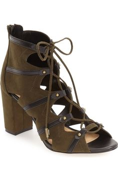 Trend-right ghillie laces and bold geometric cutouts amplify the rocker-chic attitude of this standby block-heel bootie created by Zendaya and her stylist Law Roach.