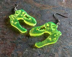 T-rex skull dinosaur earrings, laser cut acrylic (Pierced or Clip-on) Piercing t-rex piercing Weird Jewelry, Cute Jewelry, Jewelry Accessories, Funky Earrings, Skull Earrings, Dinosaur Earrings, Accesorios Casual, Laser Cut Acrylic, Style Retro