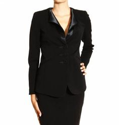 Giorgio Armani Black blazer, Chloe Black silk crepe de chine shell, and Giorgio Armani silk cocktail trousers worn by Olivia Pope (Kerry Washington) on Scandal, season 4, episode 1.