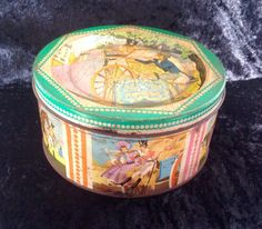 A lovely old tin , which was once full of Quality Street toffees, depicting Major Quality having his sword sharpened by a street knife/blade sharpener, made by Mackintosh in the 1950s. Tin measures 5.5 diameter by 2.6 tall. Base is stamped Mackintoshs Quality Street. Please note , this tin has had a long life and does have some scratches and minor rust spots, please study photos carefully to see condition. Please note: We are happy to post our vintage items anywhere in the world. As they…