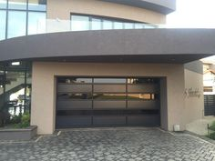 Coro-View® bronze garage door manufactured and supplied by Coroma SA Glass And Aluminium, Aluminium Doors, Garage Doors, Bronze, Outdoor Decor, Home Decor, Houses, Aluminum Gates, Decoration Home