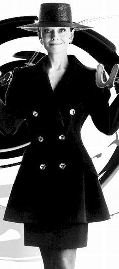 Audrey photographed by Gilles Bensimon for the French ELLE, in 1988. She is wearing creations of Hubert de Givenchy. Her suit is black silk matte, leather gloves, hat and gloves.